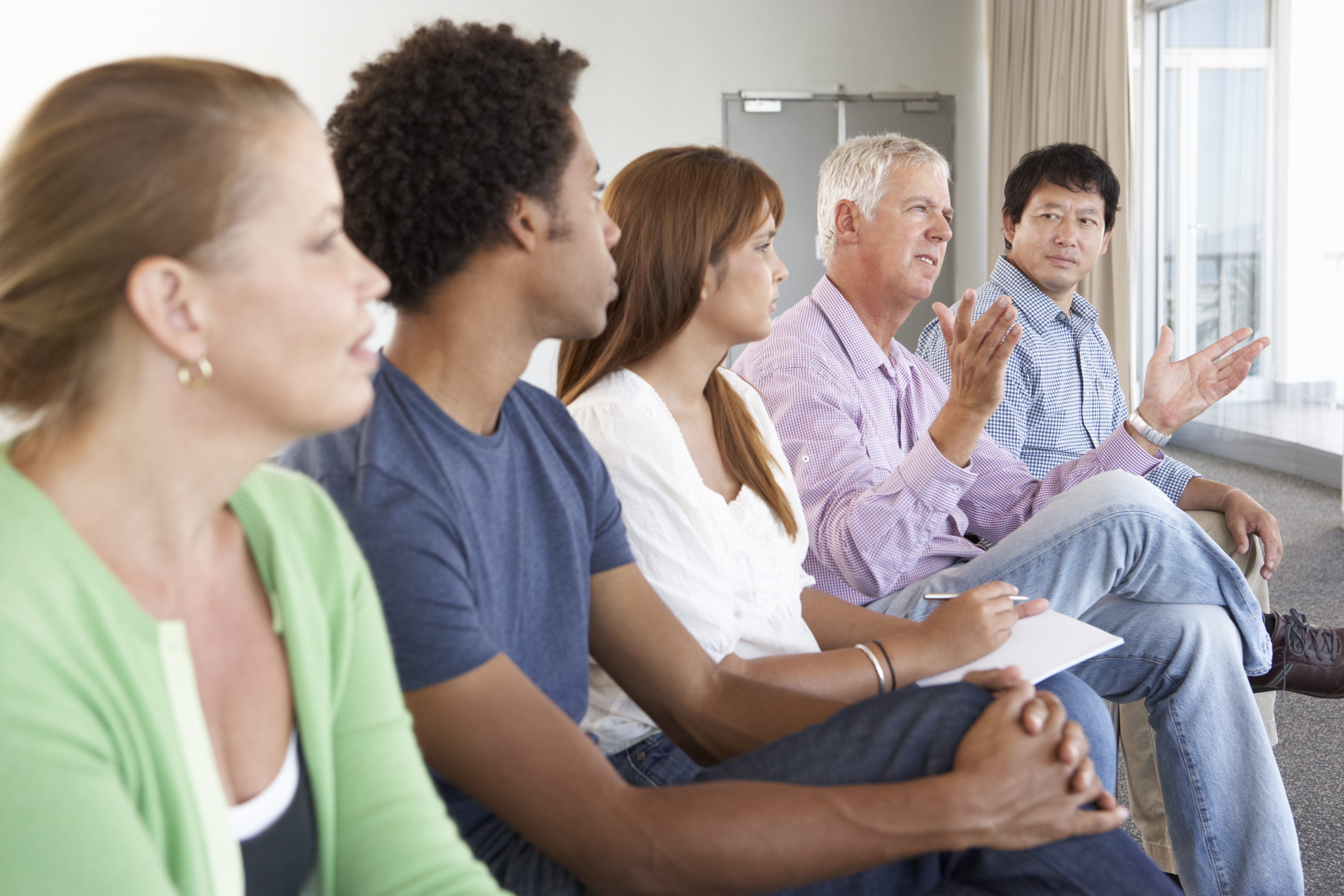 Man talking in support group meeting