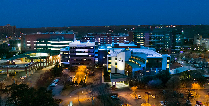An aerial shot of Gibbs Heart Center at night