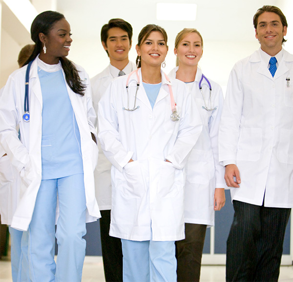 Group of pharmacy residents walking down a hospital hallway together.